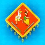Baile del hombre y de la mujer el la noche de Dandiya Foto de archivo