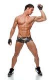 Baile descubierto atractivo muscular del hombre en el estudio Imagenes de archivo