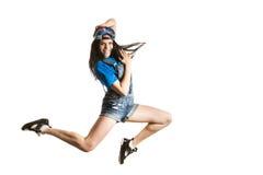 Baile feliz de la muchacha del estilo moderno aislado en el fondo blanco Concepto de salto del bailarín de Hip Hop Fotografía de archivo