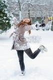 Baile feliz del adolescente en la nieve Foto de archivo libre de regalías