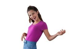 Baile sonriente de la muchacha contra el fondo blanco Imagen de archivo libre de regalías