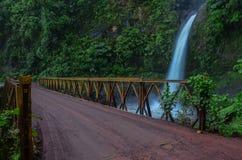 Bailey bridge and waterfall Royalty Free Stock Photos