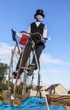 一个减速火箭的骑自行车者的吉祥人在Le环法自行车赛期间的。 免版税库存照片