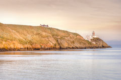 Baily Lighthouse. At the sunset in Howth peninsula, Dublin, Ireland Royalty Free Stock Images