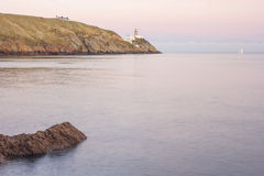 Baily Lighthouse. At the sunset in Howth peninsula, Dublin, Ireland Royalty Free Stock Photography