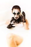 Bain effrayant de lait de clown Images libres de droits