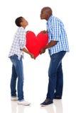 Baiser africain de couples Image libre de droits