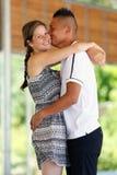 Baiser mélangé de couples Photos stock