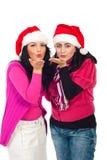Baisers de coup de femmes d'aide de Santa Images stock