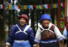 Naxi or Nashi women in the village of Baisha  with their traditional clothes stock photography
