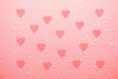 Baisse de l'eau sur la surface rose d'amour Photo libre de droits