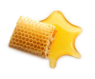 Baisse et nid d'abeilles de miel Images stock