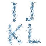 Baisse IJKL de l'eau d'alphabet Photographie stock