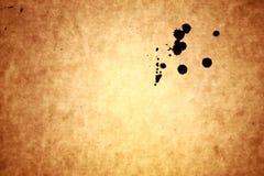 Baisses à l'encre noire sur le vieux papier Image libre de droits