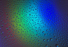 Baisses de l'eau avec la réflexion de l'arc-en-ciel Photos stock