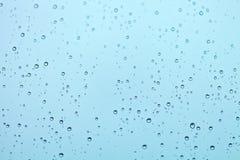 Baisses de l'eau sur l'hublot Images libres de droits
