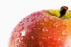 Baisses de l'eau sur la pomme Images stock
