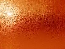 Baisses de l'eau sur la surface en verre Photographie stock