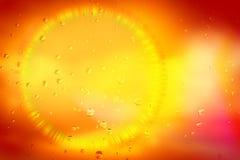 Baisses de l'eau sur le verre avec un halo Photo libre de droits