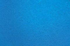 Baisses de pluie sur le tissu Image libre de droits