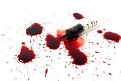Baisses de sang et d'une seringue Image libre de droits