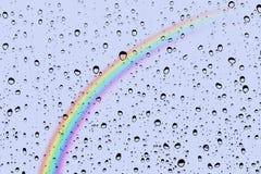 Baisses et arc-en-ciel de pluie Image libre de droits