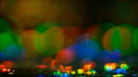 Baisses multicolores rougeoyantes de fusée colorée de lentille banque de vidéos