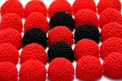 Baisses rouges et noires de gomme de sucrerie Photographie stock libre de droits