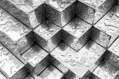 Baisses sur le cube en acier argenté Photo stock