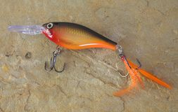 Bait. Fishing lure with treble hooks and red belly stock image