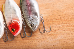 Bait for fishing - wobbler on light wood Royalty Free Stock Images