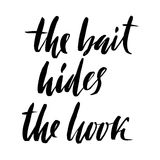 The bait hides the hook. Hand drawn lettering proverb. Vector typography design. Handwritten inscription. Royalty Free Stock Photo
