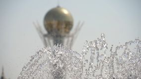 Fountain in Nur-Sultan, capital of Kazakhstan. Baiterek Tower the symbol of Nur-Sultan, capital of Kazakhstan with fountain foreground, slow motion stock video