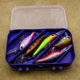 Baits for fishing on canvas background. Several wobblers of different colors in the box for fishing gear. Baits for fishing on canvas background. Several stock photo
