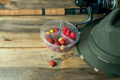 Baits, fishing rod and hat Royalty Free Stock Photo