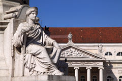 Baixa. Portugal Lisbon historical city centre -  Beautiful marble statue with the Dona Maria Theater in the background Royalty Free Stock Image
