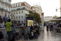 Baixa Chiado metro station in Lisbon,. LISBON, PORTUGAL - OCTOBER 23 2014: Baixa Chiado metro station in Lisbon, with street  performers singing at sunset time Stock Photography