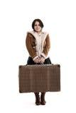 Baixa menina de sorriso com uma grande mala de viagem Imagem de Stock Royalty Free