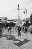 Baixa quarter, Lisbon. Typical pavement and animation in Lisbon city Stock Photography