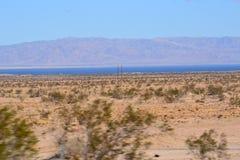 Baixo deserto com mar da sultão Foto de Stock Royalty Free