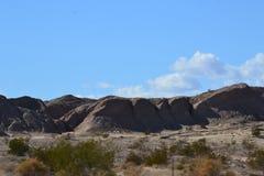 Baixo deserto com montanhas Imagens de Stock