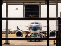 BAIYUN, GUANGZHOU, CHINA - 10 MAR 2019 - China Southern Airlines plane seen through the boarding gate window at Baiyun Airport. BAIYUN, GUANGZHOU, CHINA - 10 MAR royalty free stock photos