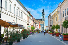 Baja street, Hungary. BAJA, HUNGARY - AUGUST 01, 2015: People on the street of Baja city center. Baja is a city in southern Hungary. Famous tourist destination Royalty Free Stock Image