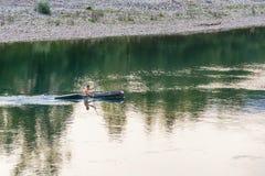 Adult male paddling in a single kayak wearing a lifejacket. Bajina Basta, Serbia July 31, 2017: Adult male paddling in a single kayak wearing a lifejacket Stock Images