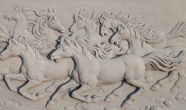Bajo-alivio de los caballos Imagen de archivo libre de regalías