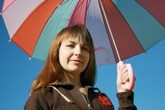 Bajo el paraguas coloreado Foto de archivo libre de regalías