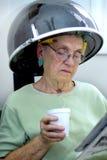 Bajo el secador de pelo Foto de archivo libre de regalías