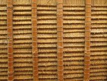 Bajo la azotea de la hierba seca Fotos de archivo libres de regalías