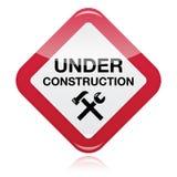 Bajo señal de peligro roja de la construcción Foto de archivo libre de regalías