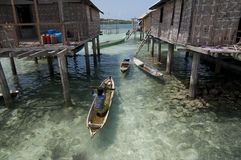 Bajo village. A woman padlling her boat at bajo village wakatobi, indonesia Royalty Free Stock Photos